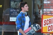 Actor Zac Efron filming a scene on the set of 'We Are Your Friends' in Burbank, California on September 5, 2014. A man on a scooter was staring at Zac as he filmed and crashed into another car in the street.