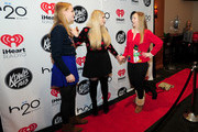 Recording artist Meghan Trainor (C) attends 101.3 KDWB's Jingle Ball 2014 presented by Sky Zone Indoor Trampoline Park and Allstate at Xcel Energy Center on December 8, 2014 in St Paul, Minnesota.