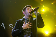 Singer Nick Jonas performs onstage during 103.5 KISS FM's Jingle Ball 2014 at Allstate Arena on December 18, 2014 in Chicago, Illinois.