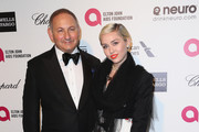 John Dempsey and singer-songwriter Miley Cyrus attend the 23rd Annual Elton John AIDS Foundation's Oscar Viewing Party on February 22, 2015 in West Hollywood, California.