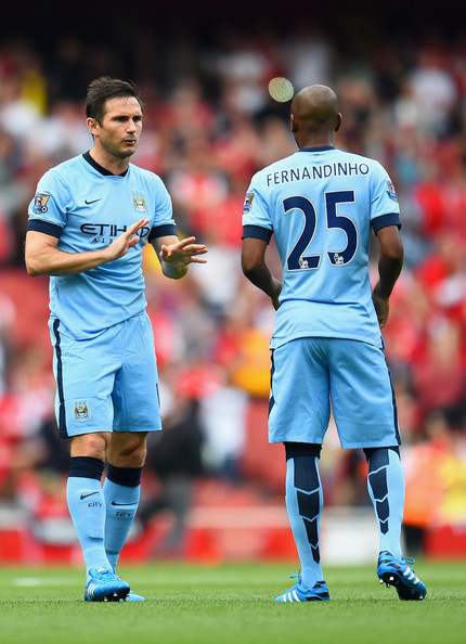 Frank Lampard of Manchester City speaks to Fernandinho of Manchester City during the Barclays Premier League match between Arsenal and Manchester City at Emirates Stadium on September 13, 2014 in London, England.