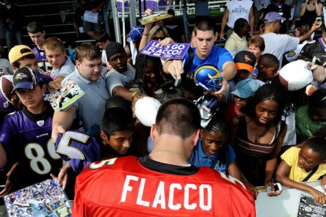 Joe Flacco signing for fans
