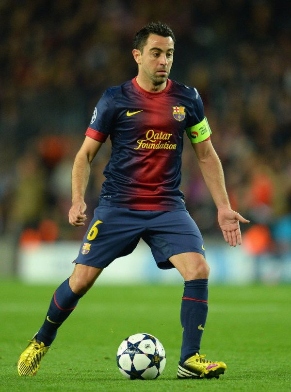 Xavi Hernandez Photos Photos - Barcelona v Paris St ...
