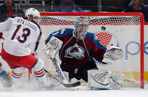 Cam Atkinson Goalie Semyon Varlamov #1 of the Colorado Avalanche looks to make a save against Cam Atkinson #13 of the Columbus Blue Jackets at the Pepsi Center on March 1, 2012 in Denver, Colorado.