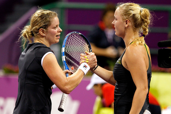 Caroline Wozniacki Kim Clijsters of Belgium is congratulated at the net by Caroline Wozniacki of Belgium after their match in the singles final on day six of the WTA Championships at the Khalifa Tennis Complex on October 31, 2010 in Doha, Qatar.
