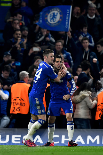 Gary Cahill (L) of Chelsea is congratulated by teammate Cesc Fabregas of Chelsea after scoring his team's first goal during the UEFA Champions League Round of 16, second leg match between Chelsea and Paris Saint-Germain at Stamford Bridge on March 11, 2015 in London, England.