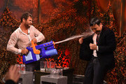 "Chris Hemsworth and Jimmy Fallon play a game of ""Water War"" during a taping of ""The Tonight Show Starring Jimmy Fallon"" at Rockefeller Center on January 13, 2015 in New York City."