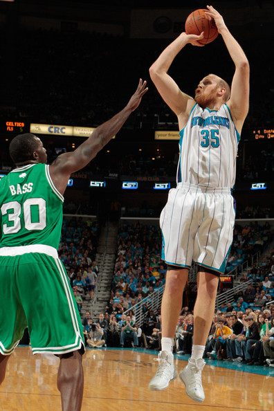 Chris Kaman Chris Kaman #35 of the New Orleans Hornets shoots the ball over Brandon Bass #30 of the Boston Celtics at New Orleans Arena on December 28, 2011 in New Orleans, Louisiana.  NOTE TO USER: User expressly acknowledges and agrees that, by downloading and or using this photograph, User is consenting to the terms and conditions of the Getty Images License Agreement.