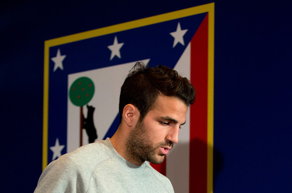 Cesc Fabregas of FC Barcelona leaves the press conference the day before the UEFA Champions League Quarter-final second leg between Atletico de Madrid and FC Barcelona at Vicente Calderon Stadium on April 8, 2014 in Madrid, Spain.