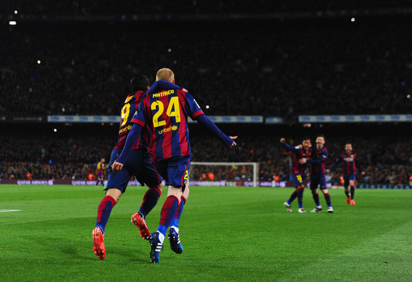 Jeremy Mathieu of Barcelona (24) celebrates with Luis Suarez (9) as he scores their first goal with a header during the La Liga match between FC Barcelona and Real Madrid CF at Camp Nou on March 22, 2015 in Barcelona, Spain.