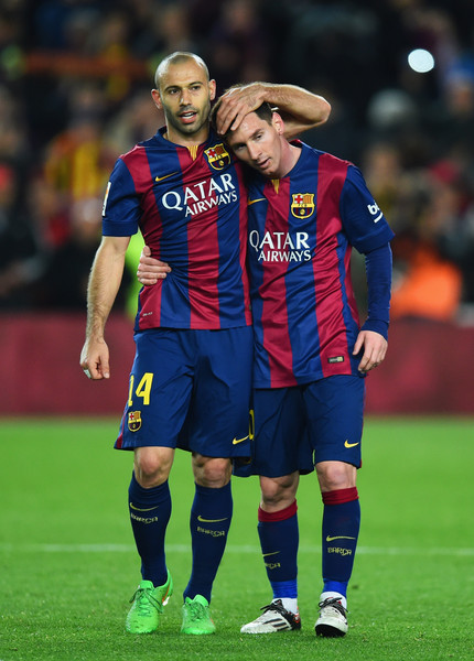 Javier Mascherano and Lionel Messi of Barcelona celebrate victory after the La Liga match between FC Barcelona and Real Madrid CF at Camp Nou on March 22, 2015 in Barcelona, Spain.