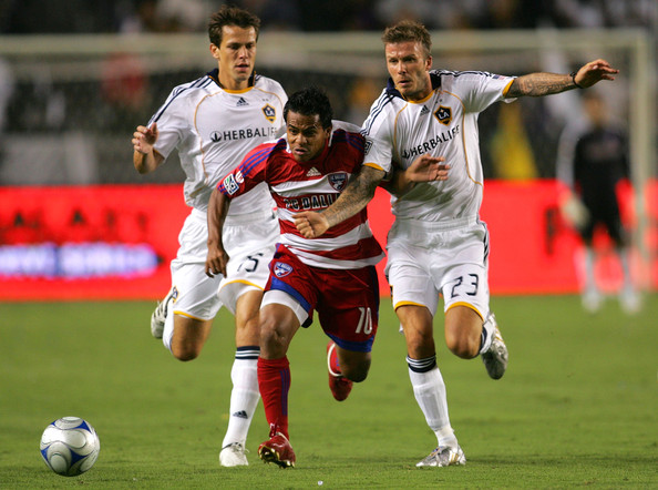 David Ferreira David Ferreira #10 of FC Dallas paces the ball past Stefani Miglioranzi #15 and David Beckham #23 of the Los Angeles Galaxy in the first half during the MLS match at The Home Depot Center on September 12, 2009 in Carson, California.