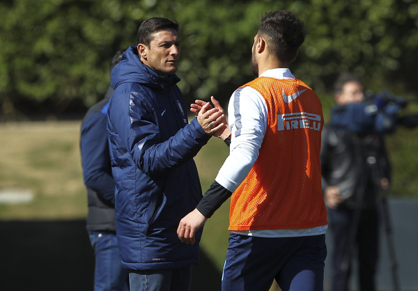 Vice President of FC Internazionale Milano Javier Zanetti shakes hands with Danilo D Amombrosio during FC Internazionale training session at the club's training ground on April 7, 2015 in Appiano Gentile Como, Italy.