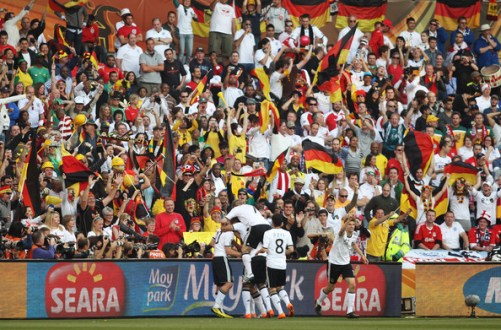Lukas Podolski of Germany is congratulated by team mates after scoring the second goal for his team during the 2010 FIFA World Cup South Africa Round of Sixteen match between Germany and England at Free State Stadium on June 27, 2010 in Bloemfontein, South Africa.
