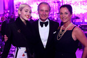 (L-R) Recording artist Miley Cyrus, president and chief executive officer, The Estee Lauder Companies, Fabrizio Freda and Marianne Freda attend the 23rd Annual Elton John AIDS Foundation Academy Awards Viewing Party on February 22, 2015 in Los Angeles, California.