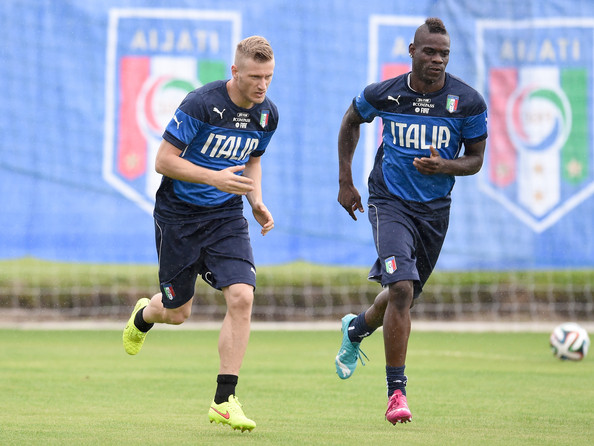 Mario Balotelli and Ignazio Abate (L) of Italy during a training session on June 10, 2014 in Rio de Janeiro, Brazil.