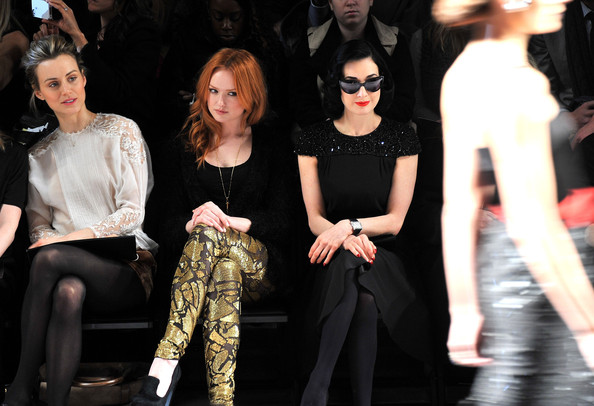 Kaylee DeFe (L-R) Actress Taylor Schilling, actress Kaylee DeFer and Dita Von Teese attend the Jenny Packham Fall 2012 fashion show during Mercedes-Benz Fashion Week at The Studio at Lincoln Center on February 13, 2012 in New York City.