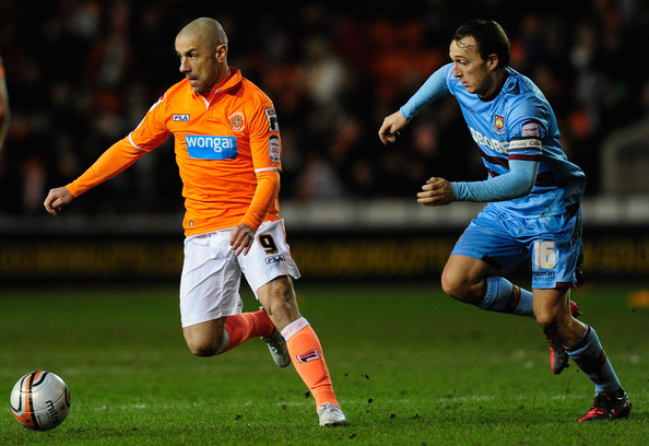 Kevin Phillips West Ham player Mark Noble (R) is beaten to the ball by  Blackpool forward Kevin Phillips during the npower Championship game between Blackpool and West Ham United at Bloomfield Road on February 21, 2012 in Blackpool, England.