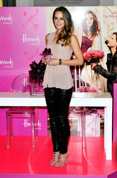 Leighton Meester poses at the launch of Vera Wang's new perfume 'Vera Wang Lovestruck' at Harrods on June 9, 2011 in London, England.