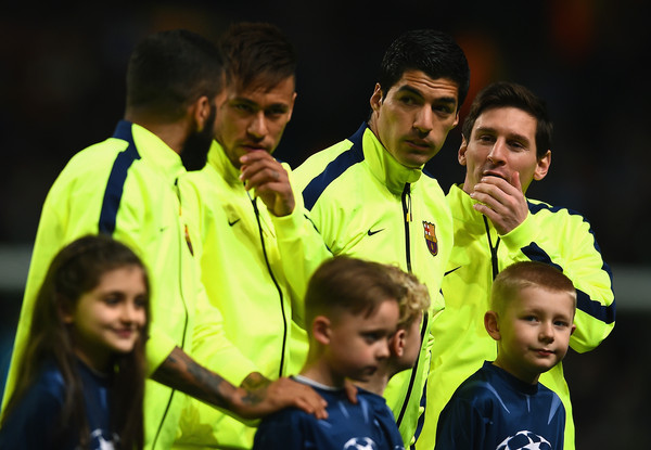 Lionel Messi (L-R) Lionel Messi, Luis Suarez and Neymar of Barcelona  line up during the UEFA Champions League Round of 16 match between Manchester City and Barcelona at Etihad Stadium on February 24, 2015 in Manchester, United Kingdom.