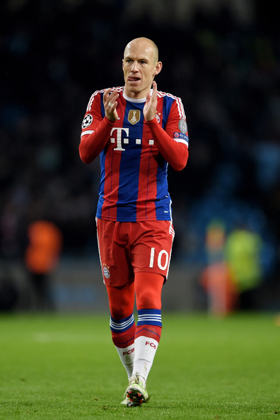 A dejected Arjen Robben of Bayern Muenchen applauds the travelling fans following his team's 3-2 defeat during the UEFA Champions League Group E match between Manchester City and FC Bayern Muenchen at the Etihad Stadium on November 25, 2014 in Manchester, United Kingdom.