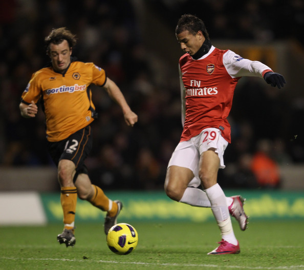 Marouane Chamakh Marouane Chamakh of Arsenal (R) scores their second goal during the Barclays Premier League match between Wolverhampton Wanderers and Arsenal, at Molineux  on November 10, 2010 in Wolverhampton, England.
