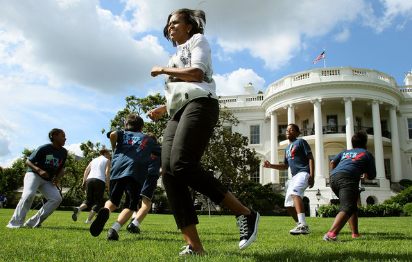 First lady Michelle Obama works out with Washington area students on the South Lawn of the White House on May 25, 2010 in Washington, DC. The first lady kicked of the first in a South Lawn series of summer activities for kids.