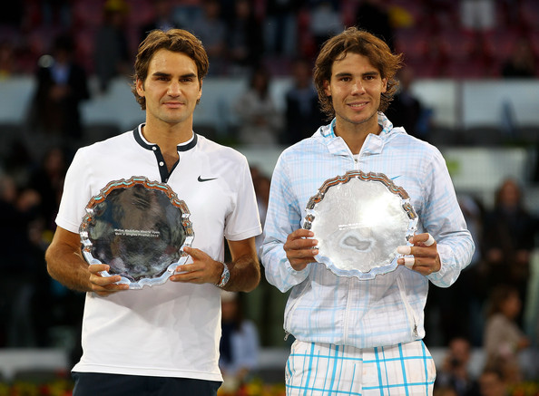Roger Federer Mens finalist Rafael Nadal and  Roger Federer of Switzerland hold aloft their trophies after the mens final match during the Mutua Madrilena Madrid Open tennis tournament at the Caja Magica on May 16, 2010 in Madrid, Spain.