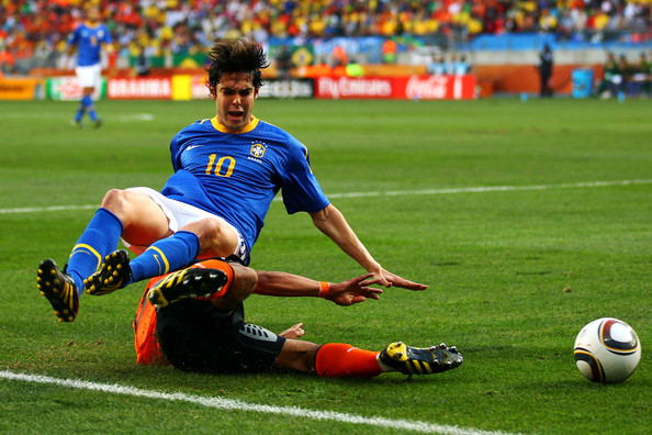 Kaka of Brazil is tackled by Nigel De Jong of the Netherlands during the 2010 FIFA World Cup South Africa Quarter Final match between Netherlands and Brazil at Nelson Mandela Bay Stadium on July 2, 2010 in Nelson Mandela Bay/Port Elizabeth, South Africa.