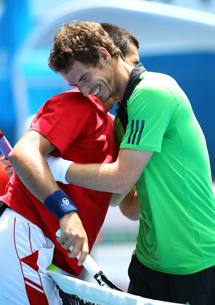 "Novak Djokovic Novak Djokovic of Serbia and Andy Murray of the United States hug at the net during the ""Rally For Relief"" charity exhibition match ahead of the 2011 Australian Open at Melbourne Park on January 16, 2011 in Melbourne, Australia."
