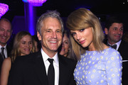 Clear Channel President of Entertainment Enterprises John Sykes (L) and recording artist Taylor Swift attend the Pre-GRAMMY Gala and Salute to Industry Icons honoring Martin Bandier at The Beverly Hilton Hotel on February 7, 2015 in Los Angeles, California.