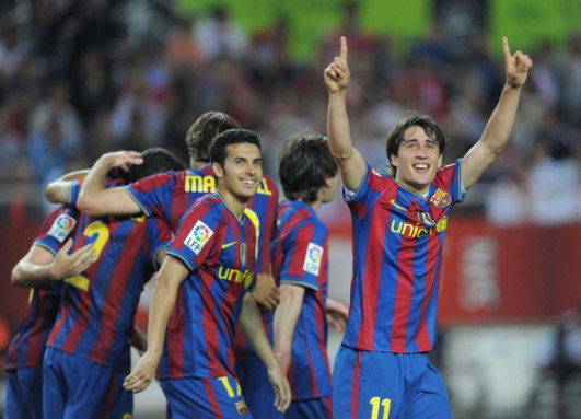 Bojan Krkic of Barcelona celebrates after scoring his team's second goal during the La Liga match between Sevilla and Barcelona at Estadio Ramon Sanchez Pizjuan on May 8, 2010 in Seville, Spain.