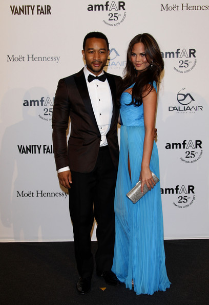 Singer John Legend and TV personality Camilla Alves attend amfAR MILANO 2011 at La Permanente on September 23, 2011 in Milan, Italy.