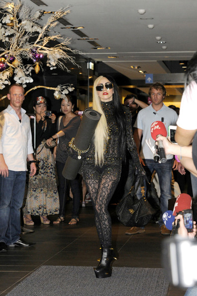 """Lady Gaga Lady Gaga wears a black and gold themed outfit coordinated with her yoga mat as she leaves a yoga class in downtown Taipei. The pop superstar, whose visit reportedly attracted nearly 500 onlookers, is in Taiwan to promote her new album """"Born This Way"""". Gaga arrived at Pure Yoga at around 3pm and stayed for a 1 hour session."""