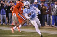 Ryan Switzer (3) runs in for a touchdown during the Atlantic Coast Conference Football Championship between the Clemson Tigers and the North Carolina Tar Heels on December 5, 2015 in Charlotte, North Carolina. Will Bratton/WRAL contributor)