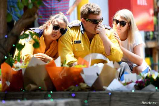 Members of the Horsley Park RFS are seen at a memorial for volunteer firefighters Andrew O'Dwyer and Geoffrey Keaton, who died…