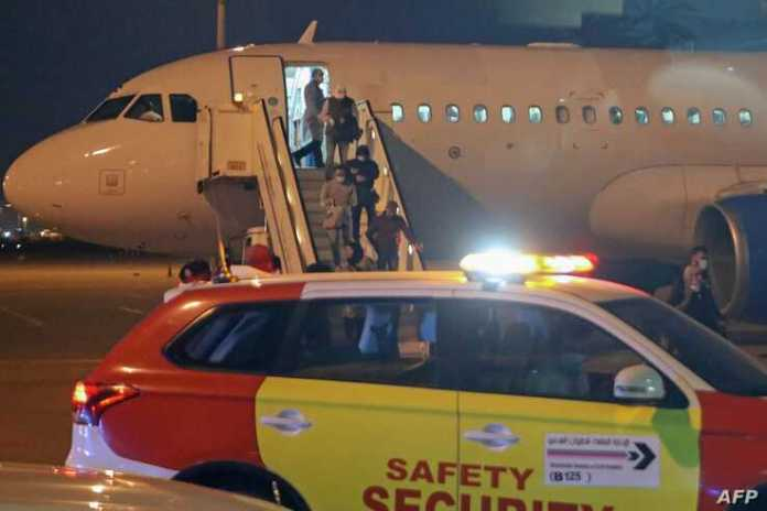 Kuwaitis coming back from Iran leave the airplane at Sheikh Saad Airport in Kuwait City, on February 22, 2020, before being…