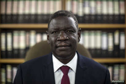 Henry Odwar, chairperson for the Committee of Energy, Mining, Commerce and Industry, poses for a photograph in Juba October 10,…