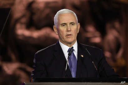U.S. Vice President Mike Pence speaks during the World Holocaust Forum in Jerusalem, Thursday, Jan. 23, 2020.   Pence, Russian…