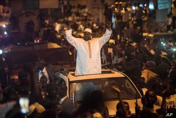 People cheer as President Adama Barrow arrives in Serrekunda, Gambia, Jan. 26, 2017. Barrow returned triumphantly to Gambia, nearly two months after winning an election disputed by the country's longtime dictator, to the cheers of hundreds of thousan