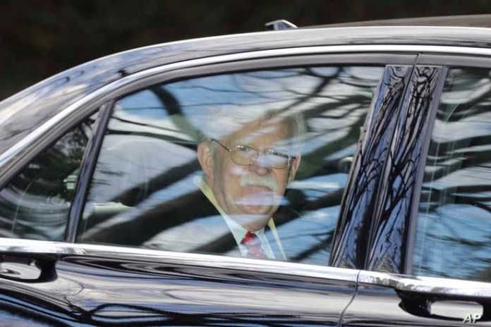 Former National security adviser John Bolton leaves his home in Bethesda, Md. Tuesday, Jan. 28, 2020. President Donald Trump's…
