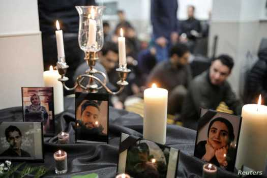 FILE PHOTO: Photographs of student victims of a Ukrainian passenger jet which crashed in Iran are seen during a vigil at…