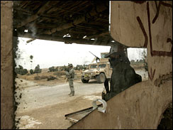 An Iraqi volunteer civilian and a US soldier of 3rd Brigade Combat team, 3rd Infantry Division at a check point in Al-leg