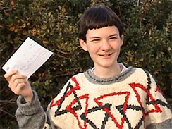 In this photo released by the Fernandez family on Thursday, Jan. 7, 2010, home-schooled Arran Fernandez, 14, poses with the offer he received to join Fitzwilliam College at Cambridge University in October, in London.