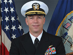Navy Capt. Owen Honors is shown in this undated official portrait. The top officer aboard a nuclear-powered aircraft carrier broadcast to his crew a series of profanity-laced comedy sketches in which he uses gay slurs, mimics masturbation and opens the shower curtain on women pretending to bathe together, a newspaper reported.