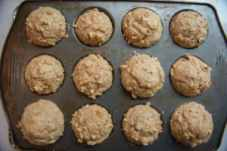 Baked healthy banana oat muffins cooling in the muffin pan on a wire rack
