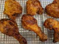 Fried chicken cooling on a wire cooling rack