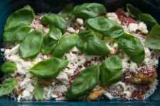 chicken parmesan topped with fresh basil