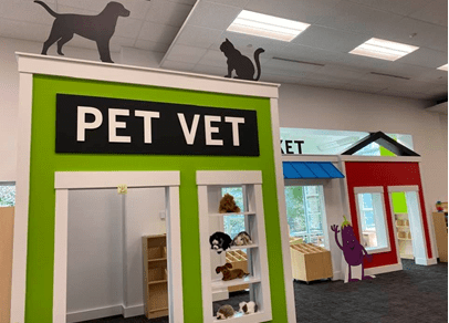 The Village area of the Idea Studio features a pet vet, market, and house full of play furniture and books. (WYDaily/Courtesy of Williamsburg Regional Library)