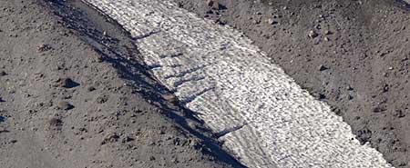 A close-up view of the mini-glaciers reveals classic crevasses